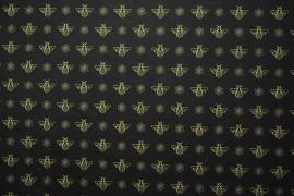 Tkanina dekoracyjna - pszczoły na czarnym tle