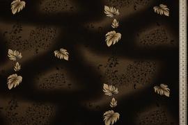 Tkanina sukienkowa - beżowe listki na brązowym tle