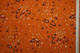 Tkanina sukienkowa - wzór na pomarańczowym tle