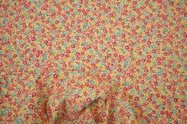 Bawełna drukowana w miętowe, pomarańczowe, żółte, czerwone kwiatki na jasnożółtym tle
