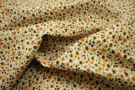 Bawełna drukowana w pomarańczowe i zielone kwiatki na jasnozielonym tle
