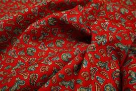 Bawełna drukowana w turkusowe i czerwone wzory na czerwonym tle