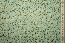 Bawełna drukowana - seledynowe tło w żółte kwiatki