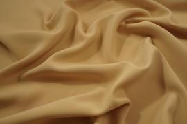 Tkania żorżeta w kolorze beżowym