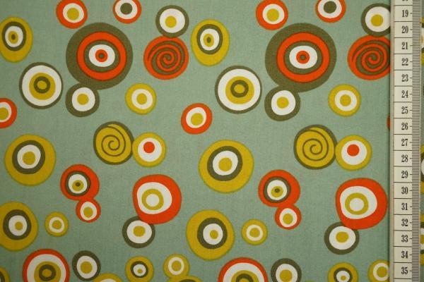 Bawełna drukowana w kolorze seledynowym w kolorowe kółka