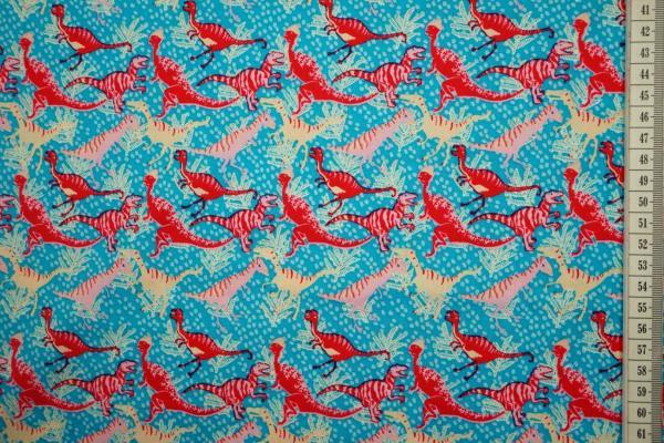 Bawełna drukowana - dinozaury na niebieskim tle