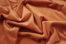 Welur w kolorze ciemnopomarańczowym