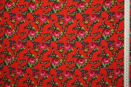 Tkanina regionalna w róże na czerwonym tle