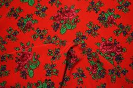 Tkanina regionalna w duże róże na czerwonym tle