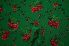 Tkanina regionalna w duże róże na zielonym tle