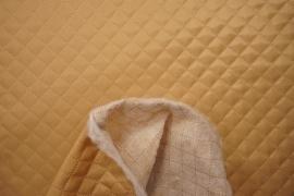 Podszewka pikowana w kolorze złotym