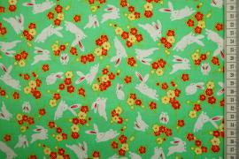 Bawełna drukowana w króliki i kwiatki na zielonym tle