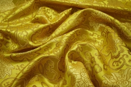 Żakard w kolorze złotym