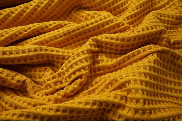 Bawełna wafel w kolorze musztardowym