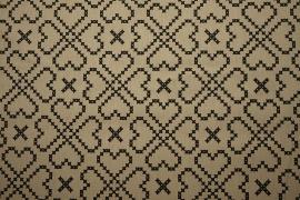 Tkanina ogrodowa - serca na beżowym tle