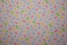 Bawełna - cukierki na różowym tle