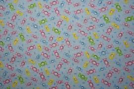 Bawełna - cukierki na niebieskim tle